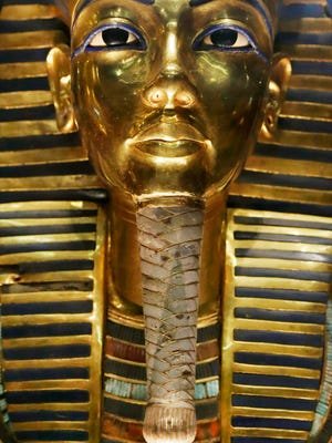 In this Saturday, Jan. 24, 2015 file photo, The gold mask of King Tutankhamun is seen in a glass case during a press tour, in the Egyptian Museum near Tahrir Square, Cairo.