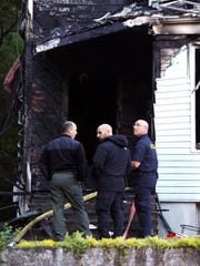 Investigators at the scene of a two-family home on Chestnut Street in Morristown was destroyed early Friday morning, the occupants got out safely but six pets were feared to have perished in the fire. June 10, 2016, Morristown, NJ