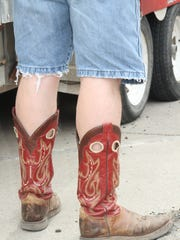 Even though temperatures reached the mid-90s, cowboy boots were still the style of choice for many at Cavern Fest.