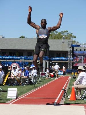 Middletown graduate Marquis Dendy attempts his long jump during the Olympic Trials in Portland, Oregon on Saturday.