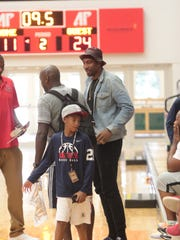 Miami Heat forward Amar'e Stoudemire watches his son play for the E1T1 Rebels during their AAU Boys 10U tournament game Saturday at Austin Peay's Dunn Center.