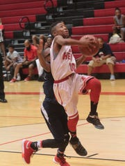 FA Heat's Jakobie Boose (30) goes up for a lay up against