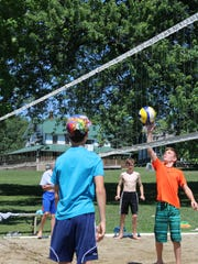 Liam Monahan, 13, of Richmond, hits a volleyball during