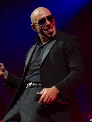 Pitbull performs at Talking Stick Resort Arena on Sunday, July 17, 2016, in Phoenix.