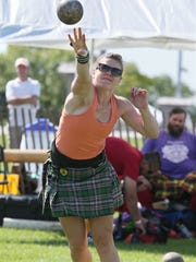 Katie Crowley competes in the women's heavy weight push the Wisconsin Highland Games. This year's Games are this weekend at the Waukesha Expo Center.