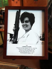 A photograph shows Loreen Klauser of Muskego during the prime of her trapshooting career and lists many of her accomplishments.