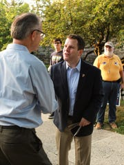 Sean Barney greets voters Tuesday in Wilmington. Barney, a Democrat, was running for Congress.