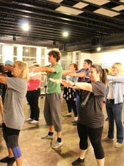 Cast members from 'Young Frankenstein' practice. The