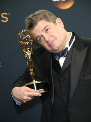 Patton Oswalt poses in the photo room with his Emmy.