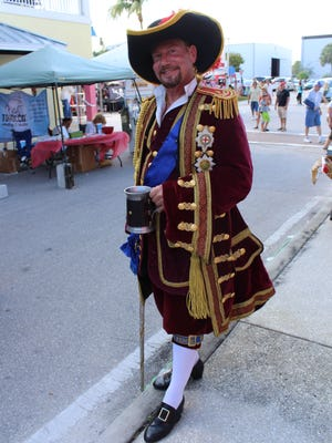 Pirates roam the streets at the annual Fort Myers Beach Pirate Festival.