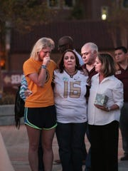 Cummins' family meets with her friends and sorority sisters at the vigil Wednesday night.