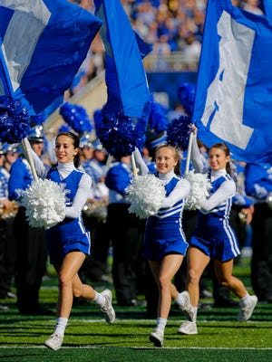 Kentucky cheerleaders lead the team onto the field before the game. Oct. 8, 2016