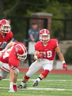 Johnstown product Cody Farley looks for running room in a recent Denison win. The Big Red are 7-0 for the first time since 1985.