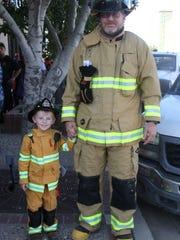 Loving volunteer firefighter Chris Mathews accompanies