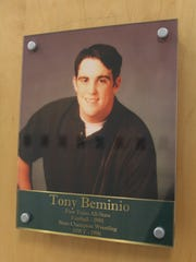 """A photo of Sgt. Anthony """"Tony"""" Beminio when he was a student hangs in West High's Athletics Hall of Fame on Nov. 2, 2016."""