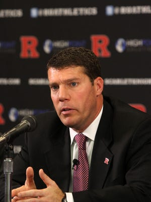 File photoCounting head coach Chris Ash's salary of $2 million, the total compensation for Rutgers' coaching staff topped $4 million. Rutgers University President Robert Barchi and Rutgers University Director of Athletic Patrick Hobbs announce (pictured) Chris Ash has been named head coach of the Rutgers University Scarlet Knights football program during a press conference in the Hale Center at Rutgers University in Piscataway, NJ Monday December 7, 2015. Rutgers University Scarlet KNights football coach Chris Ash speaks during the press conference.