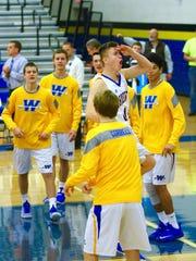 Waynesboro's Evan Hine (center) gets pumped with his