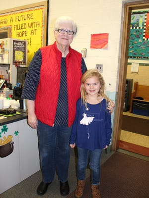 Principal for the Day Clara Blatt assists Immaculate Conception School Principal Connie Snyder.