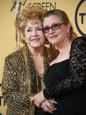 Debbie Reynolds and Carrie Fisher at the Screen Actors Guild Awards together in 2015.