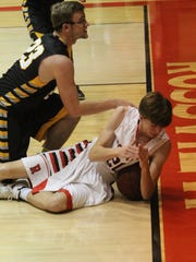 Rossview's Will Midlick (20) tries to call for a timeout during a game last year.