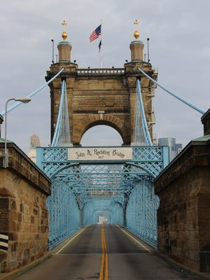 The John A. Roebling Suspension Bridge, as seen from Covington, was closed to traffic for a Cincinnati Bell commercial shoot. The commercial will air locally during the Super Bowl.