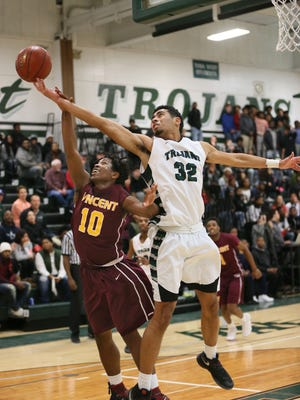 Wauwatosa West's Tyrone Powell tries to keep control of the ball and away from Milwaukee Vincent's Robert Anderson on Dec. 21. West is 5-2 in the Woodland West.