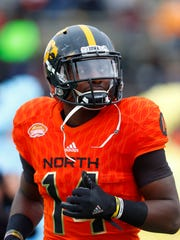 North squad cornerback Desmond King of Iowa (14) runs on the field during the player introductions of the Senior Bowl NCAA college football game, Saturday, Jan. 28, 2017, at Ladd-Peebles Stadium in Mobile, Ala.