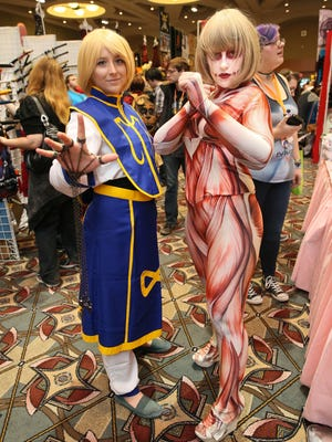Sisters Elaine Tripp of Sturgeon Bay (left) and Anna Grishaber of Appleton attend the 2016 edition of Anime Milwaukee, held at the Wisconsin Center and Hyatt Regency Milwaukee.