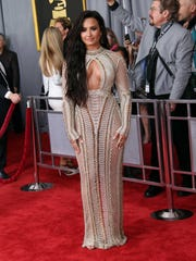 Demi Lovato arrives at the 59th Annual Grammy Awards at Staples Center.