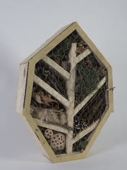 It's cozy and fragrant. A bug hotel in the shape of a leaf is filled with leaves, sticks and pine cones.