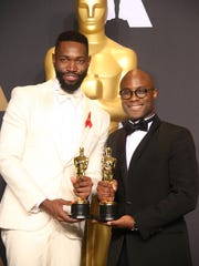 Tarell Alvin McCraney (L) and Barry Jenkins pose with the Oscars for Best Adapted Screenplay for 'Moonlight' in 2017.