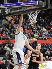 Moravia's Gabe Short scores on a layup during Sunday's Class C state quarterfinal at Floyd L. Maines Veterans Memorial Arena in Binghamton. The Blue Devils won, 66-59.