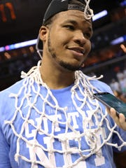 North Carolina Tar Heels forward Kennedy Meeks (3) wears one of the nets  after defeating the Kentucky Wildcats in the finals of the South Regional of the 2017 NCAA Tournament at FedExForum.