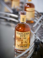 Bottles of Templeton Rye are moved on their production