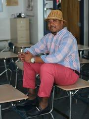 Styles files candidate Kenneth Gatson wears pink Izod