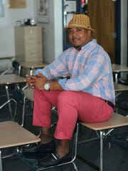Styles files candidate Kenneth Gatson wears pink Izod pants and plaid Izod shirt, both from JCPenney; navy blue Bally shoes with matching belt, both from the Bally store in Atlanta; and a straw Fedora hat.