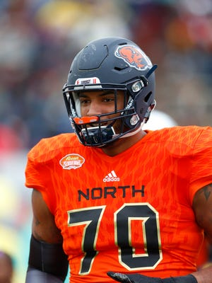 North squad offensive tackle Julien Davenport of Bucknell (70) runs on the field during player introductions of the Senior Bowl NCAA college football game, Saturday, Jan. 28, 2017, at Ladd-Peebles Stadium in Mobile, Ala. (AP Photo/Butch Dill)