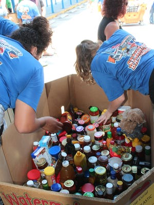 Volunteers sort canned goods at the Cape Coral post office during a Stamp Out Hunger Food Drive.