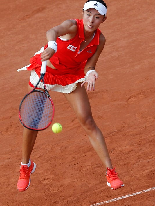 China's Qiang Wang serves against Venus Williams of the U.S. during their first round match of the French Open tennis tournament at the Roland Garros stadium, in Paris, France. Sunday, May 28, 2017. (AP Photo/Michel Euler)