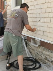 Homeowner Bill Stull grabbed a paint brush and helped