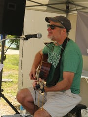 Casey Redmond provided music for the opening day of the Delhi Farmers Market.