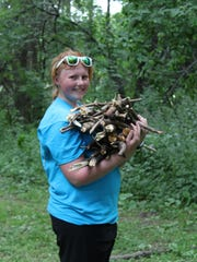 Katie Zimmer of the Flambeau FFA gathers firewood at the Goodman Youth Farm during the 9th annual Wisconsin FFA Day of Service on June 12.