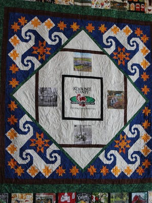 This keepsake quilt created by the Kewaunee County Home and Community Education group weaves together the Ebert family history and the diversity of agriculture in Kewaunee County.