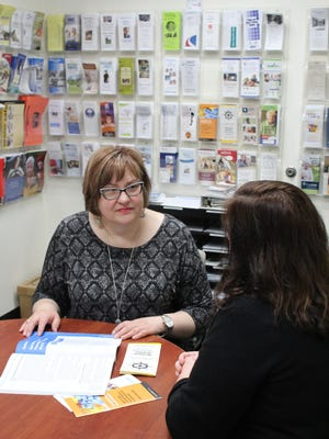 Monica Froh, disability benefit specialist at the Aging & Disability Resource Center (ADRC) of Sheboygan County, discusses coordination of services with a Sheboygan County resident.