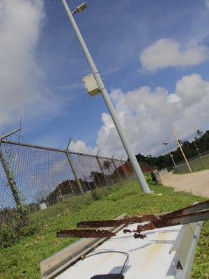 A fallen solar panel lays on the ground next to the light post it once powered July 11, 2017. The metal bars that fastened the panel to the post appeared corroded and rusted out.