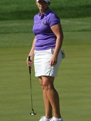 Angela Stanford reacts after a putt on the ninth green