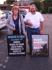John and Deb Boyer of Ashland participate in a candlelight