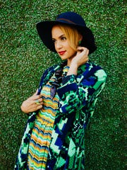 Georgia Bullock jacket, at Roxy Deluxe. Vintage panther dress, necklace and agate ring, at New/Found. Fred Segal hat, at The End. Kate Spade earrings, stylist's own.