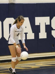 Estero senior Gracie Cory lines up for a serve during