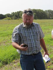 Checking out a soil sample on the Josh Hiemstra Family dairy farm near Brandon during the Summer Field Day on Aug. 24.